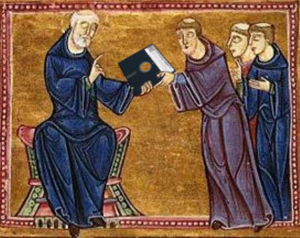 Image of medieval monks looking at a floppy disk.
